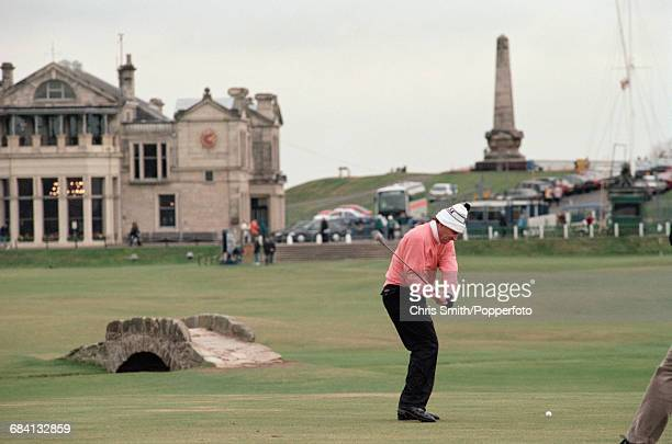 Zimbabwean golfer Nick Price pictured in action in front of the Royal and Ancient Clubhouse during competition for the Zimbabwe team in the 1994...