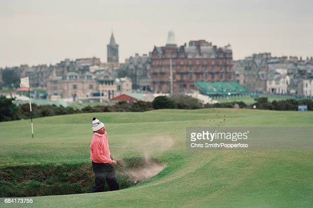 Zimbabwean golfer Nick Price pictured in action playing out of a sandtrap during competition for the Zimbabwe team in the 1994 Dunhill Cup golf...