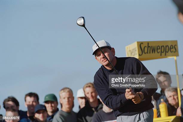 Zimbabwean golfer Nick Price pictured in action with a driver during competition to finish in joint 29th place in the 1998 British Open Championship...