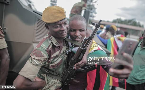Zimbabwean man takes photo with military during inauguration of new president Emmerson Mnangagwa at Harare International Stadium People in Harare on...