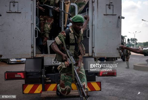 Zimbabwean military personnel arrive to secure the area ahead of the ceremony at the National Sport Stadium in Harare on November 24 2017 during the...