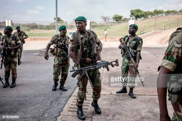 TOPSHOT Zimbabwean military personnel arrive to secure the area ahead of the ceremony at the National Sport Stadium in Harare on November 24 2017...