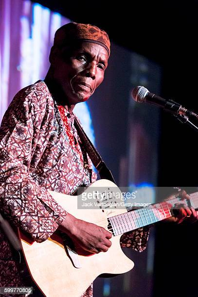 Zimbabwean musician Oliver Mtukudzi plays acoustic guitar on the Acoustic Africa Tour at BB King Blues Club Grill in Times Square New York New York...