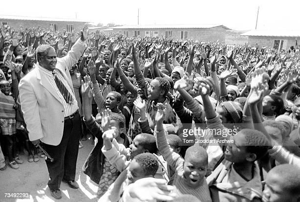 Zimbabwean nationalist leader and founder of the Zimbabwe African People's Union Joshua Nkomo with a group of supporters Harare April 1980