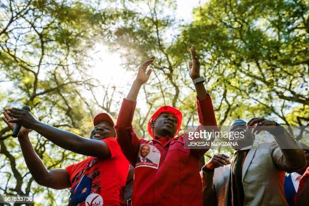 Zimbabwean opposition leader Nelson Chamisa gestures as he takes part in a demonstration outside the Zimbabwe Electoral Commission in Harare on June...