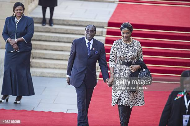 Zimbabwean President Robert Gabriel Mugabe arrives with his wife Grace Mugabe for the inauguration ceremony of the newly reelected South African...
