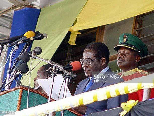Zimbabwean President Robert Mugabe addresses 12 January 2005 President of Zanzibar Amanai Abeid Karume and the people of Zanzibar at Amanu stadium...