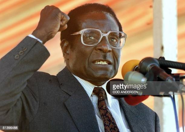 Zimbabwean President Robert Mugabe addresses Zanu PF followers at a rally in the Harare suburb of Highfield 17 June 2000 Some 5000 people gathered to...