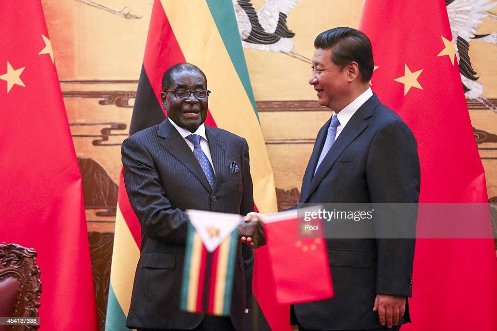 Zimbabwean President Robert Mugabe Visits China : News Photo