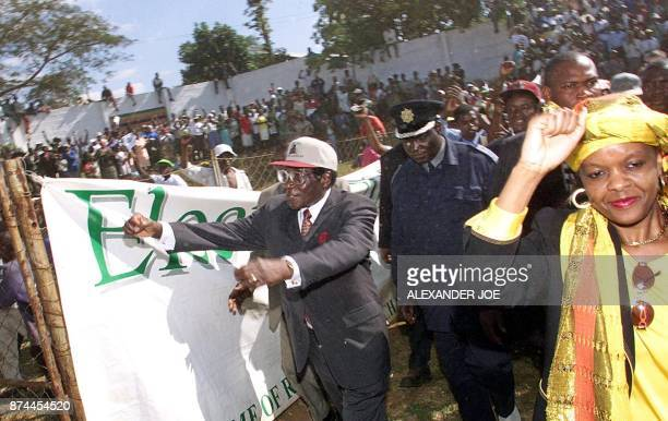 Zimbabwean president Robert Mugabe and his wife Grace greet supporters at a rally in Chinhoyi 23 June on the eve of the parliamentary elections...