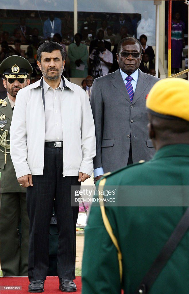 Zimbabwean President Robert Mugabe (R) and Iranian President Mahmoud Ahmadinejad (L) stand at a parade during the official opening of the international trade fair on April 23, 2010, in Zimbabwe's second city of Bulawayo. Ahmadinejad accused today world powers of trying to destroy the economies of Zimbabwe and his own nation, which faces the threat of toughened sanctions. Zimbabwe enjoys good relations with Iran as well as several east Asian countries after Mugabe launched a 'Look East' policy in response to isolation by the West following Harare's controversial land reforms and disputed 2002 elections. AFP PHOTO/Desmond Kwande