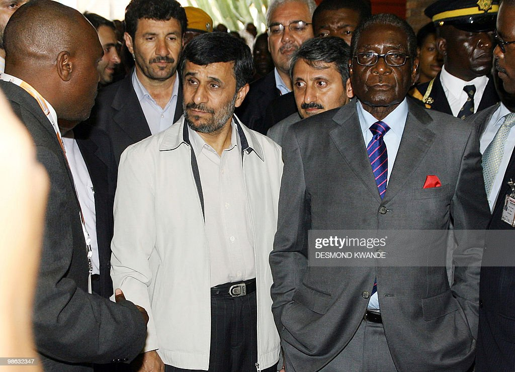 Zimbabwean President Robert Mugabe (R) and Iranian President Mahmoud Ahmadinejad (2L) attend the official opening of the international trade fair on April 23, 2010, in Zimbabwe's second city of Bulawayo. Ahmadinejad accused today world powers of trying to destroy the economies of Zimbabwe and his own nation, which faces the threat of toughened sanctions. Zimbabwe enjoys good relations with Iran as well as several east Asian countries after Mugabe launched a 'Look East' policy in response to isolation by the West following Harare's controversial land reforms and disputed 2002 elections. AFP PHOTO/Desmond Kwande