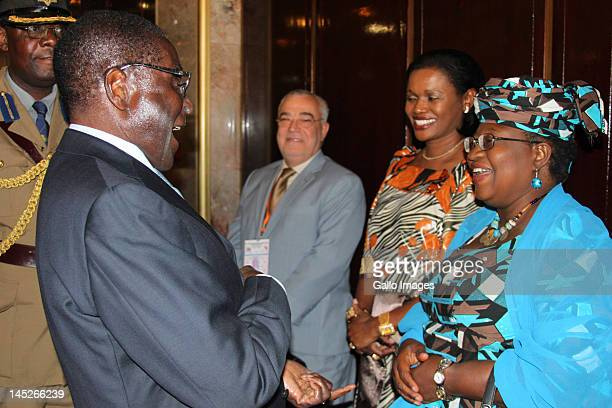 Zimbabwean President Robert Mugabe chats to Nigerian minister of Finance Dr Ngozi Okonjo-lweala with Queen of Buganda Sylvia Magginda Nnangareka...