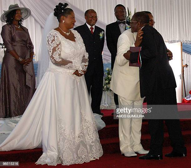 Zimbabwean President Robert Mugabe congratulates Malawian President Bingu wa Mutharika during his wedding ceremony with his bride Callista Chimombo...