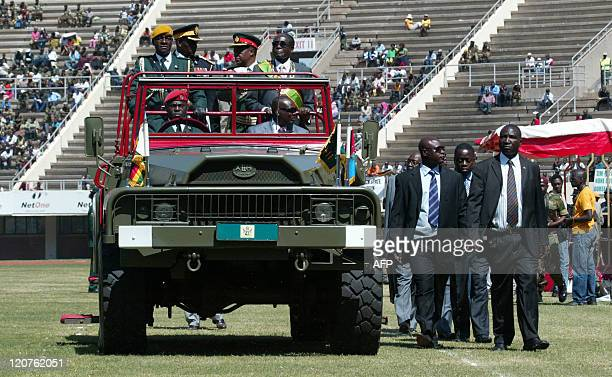 Zimbabwean President Robert Mugabe flanked by the commander of the defence forces Constantine Chiwenga inspects the guard of honour at the National...