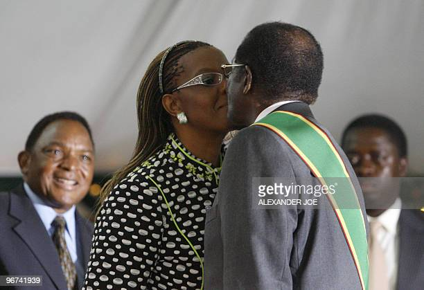 Zimbabwean President Robert Mugabe is being congratulated by his wife Grace Mugabe after being sworn in for a sixth term in office in Harare on June...