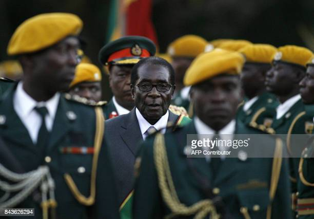 Zimbabwean President Robert Mugabe is hastily sworn in for a sixth term in office in Harare on June 29 2008 after being declared the winner of a...