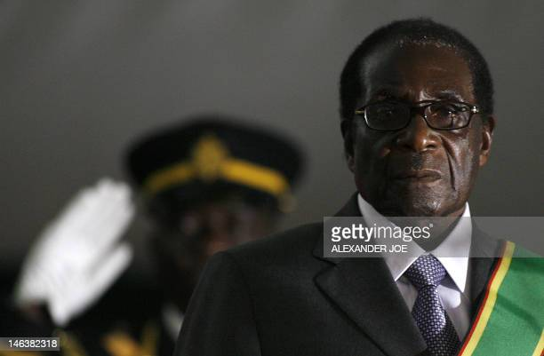 Zimbabwean President Robert Mugabe is sworn in for a sixth term in office in Harare on June 29 2008 after being declared the winner of a oneman...