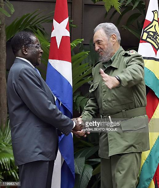 Zimbabwean President Robert Mugabe is welcomed by Cuban President Fidel Castro at the State Council in Havana 12 September 2005 Mugabe landed in Cuba...