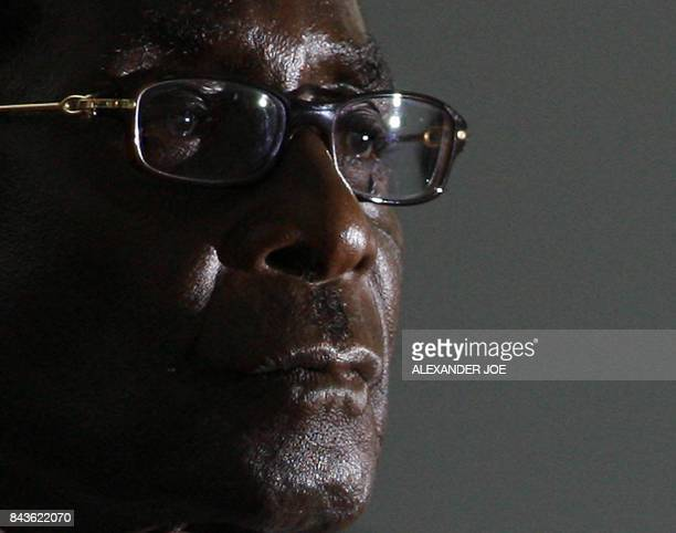 Zimbabwean President Robert Mugabe looks on as hi is sworn in for a sixth term in office in Harare on June 29 2008 after being declared the winner of...