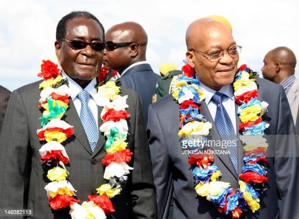 Zimbabwean President Robert Mugabe poses with South African President Jacob Zuma on November 26, 2010 at the Harare International airport. Zuma...
