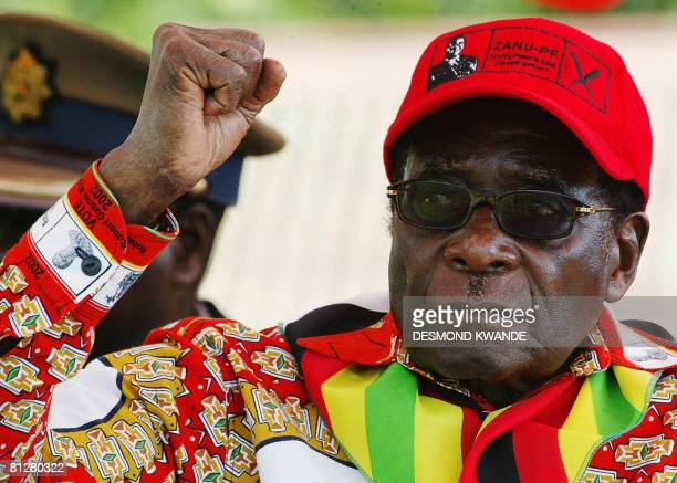 Zimbabwean President Robert Mugabe raises his fist on May 29 2008 at a rally in Mvurwi some 100km from Harare President Mugabe will never vacate his...