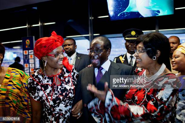 Zimbabwean president Robert Mugabe with his wife Grace Mugabe and Winnie Mandela in the presidential suite during the final of Africa's Cup at Soccer...