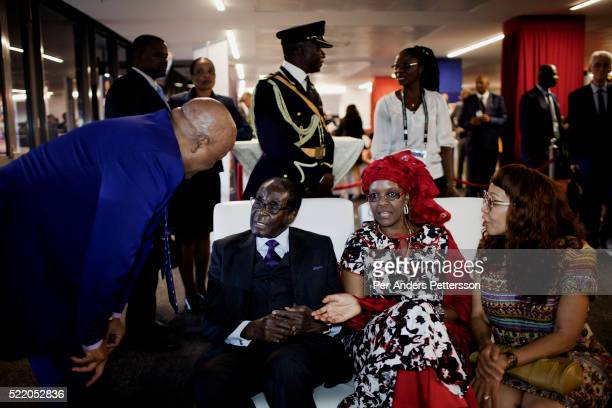 Zimbabwean president Robert Mugabe with his wife Grace Mugabe chats with other dignitaries in the presidential suite during the final of Africa's Cup...