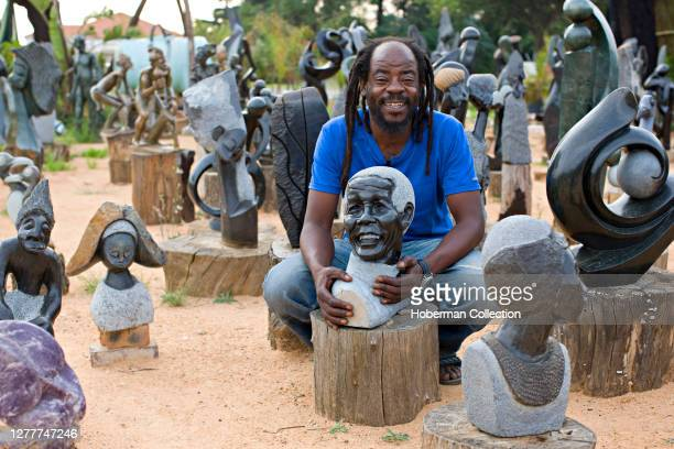 Zimbabwean soap stone scultor at market