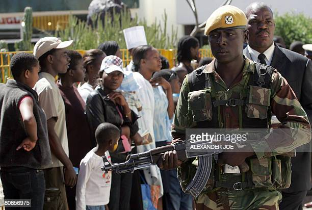 A Zimbabwean soldier secures the area as Zimbabwe President Robert Mugabe toors The Zimbabwe Internatinal Trade Fair in Bulawayo on April 25 2008 AFP...