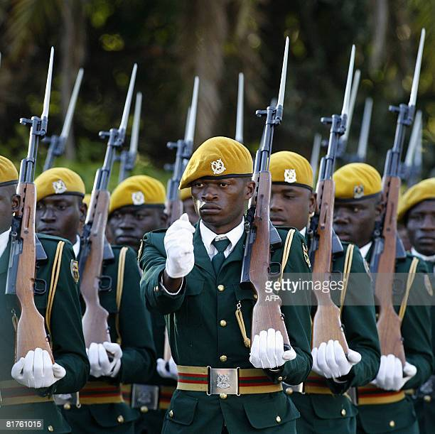 Zimbabwean soldiers attend Zimbabwean President Robert Mugabe's swearing in ceremony for a sixth term in office in Harare on June 29 2008 after...