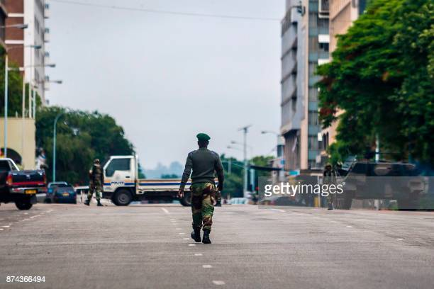 Zimbabwean soldiers stand at an intersection as they regulate traffic in Harare on November 15 2017 Zimbabwe's military appeared to be in control of...