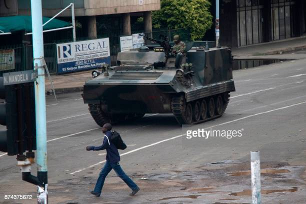 Zimbabwean soldiers stand by an intersection as they regulate civilian traffic in Harare on November 15 2017 Zimbabwe's military appeared to be in...