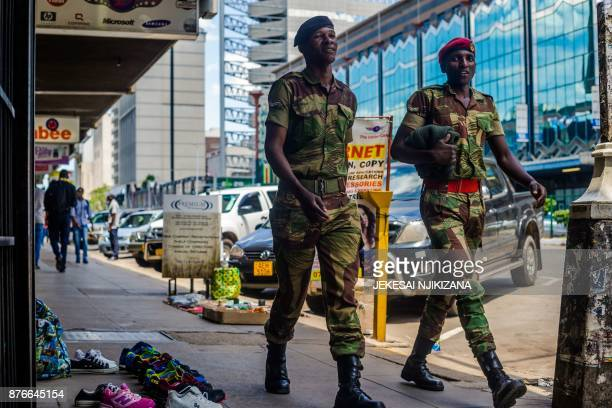 Zimbabwean soldiers walk by main streets in the Central Business District of Harare on November 20 2017 Zimbabwe is locked in one of its worst...