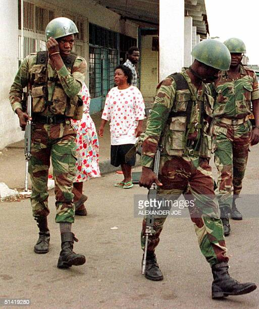 Zimbabwean troops patrol 21 January in a street of Highfiles a suburb of Harare President Robert Mugabe ordered 20 January the army into the city to...