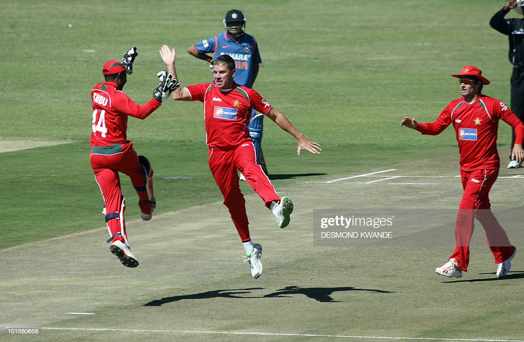 Zimbabwean wicket keeper Tatenda Taibu and Bowler Raymond Price celebrating after taking the wicket of Indian batsman Yusuf Pathan at Harare Sports Club on June 3, 2010 in the fourth match of the Micromax Cup Triangular One-Day series which includes Sri Lanka. AFP PHOTO / Desmond Kwande