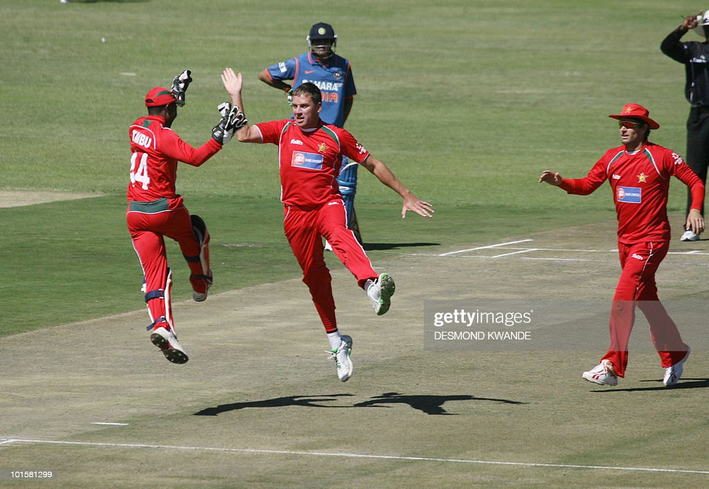 Zimbabwean wicket keeper Tatenda Taibu (L) and bowler Raymond Price (C) celebrate after taking the wicket of Indian batsman Yusuf Pathan at the Harare Sports Club on June 3, 2010 during a one-day international, part of a tri-nations series that includes Sri Lanka. AFP PHOTO / Desmond Kwande