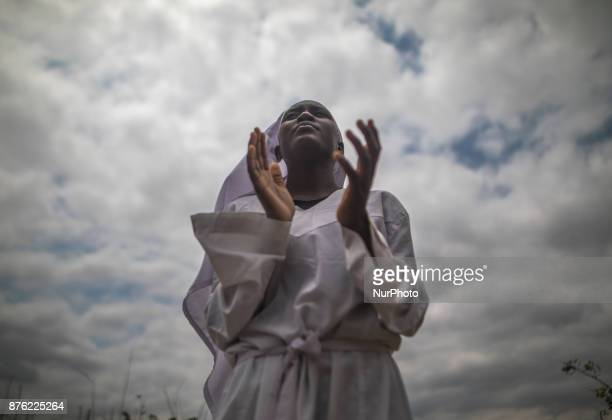 A Zimbabwean woman leads a prayer outdoors in in Harare Zimbabwe on 19 November 2017 a day after huge crowds rallied peacefully in the capital for...