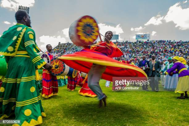 TOPSHOT Zimbabwean worshippers and congregants from various indigenous church denominations perform and dance as they wait to be addressed by...