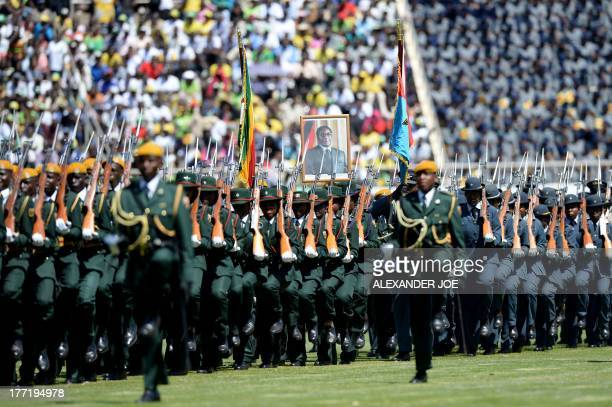 Zimbabwean's Guards of Honor march during veteran leader Robert Mugabe's swearingin ceremony in Harare on August 22 2013 at the 60000seater sports...