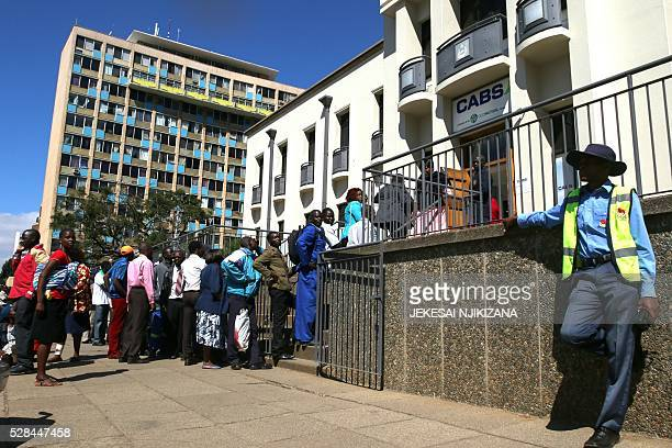 Zimbabweans queue to withdraw cash outside a bank on May 5 2016 in Harare Zimbabwe Zimbabweans formed long queues outside banks on May 5 after the...