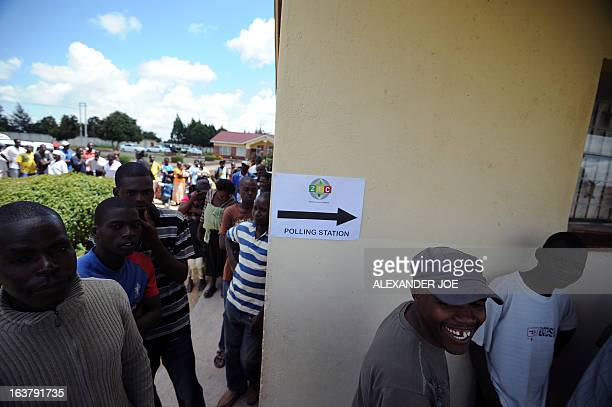 Zimbabweans stand in line waiting to cast their vote in Epwath on March 16 2013 for Zimbabwe's referendum for a new constitution for the country to...