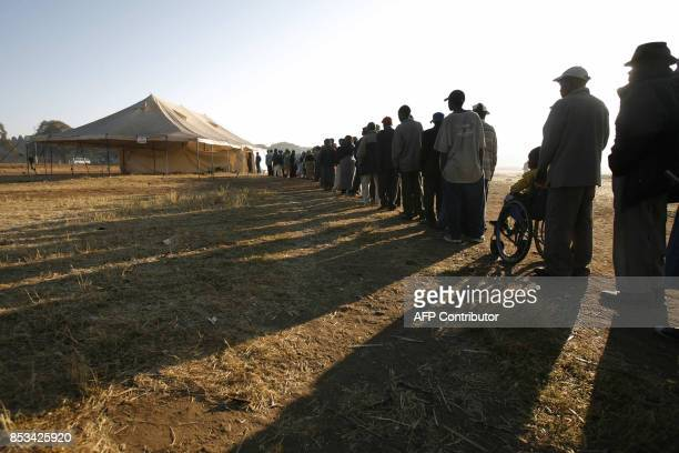 Zimbabweans wait to vote in the presidential election runoff at a polling station in Harare on June 27 2008 Zimbabwe is voting in an election which...