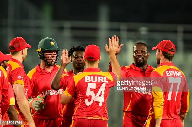 Zimbabwe's Ainsley Ndlovu celebrates after with teammates after the dismissal of Afghanistan's Asghar Afghan during the second match between...
