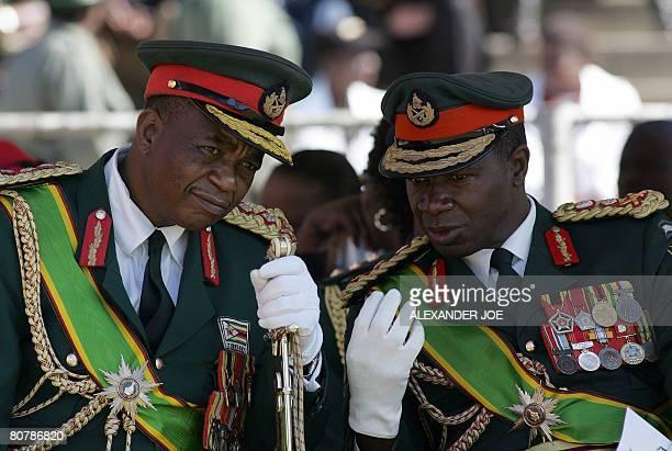 Zimbabwe's Army commander General Constantine Chiwenga chats with commander of the Zimbabwe National Army LieutenantGeneral Phillip Valerio Sibanda...