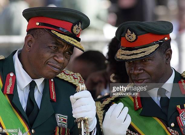 Zimbabwe's Army commander General Constantine Chiwenga listens to commander of the Zimbabwe National Army LieutenantGeneral Phillip Valerio Sibanda...