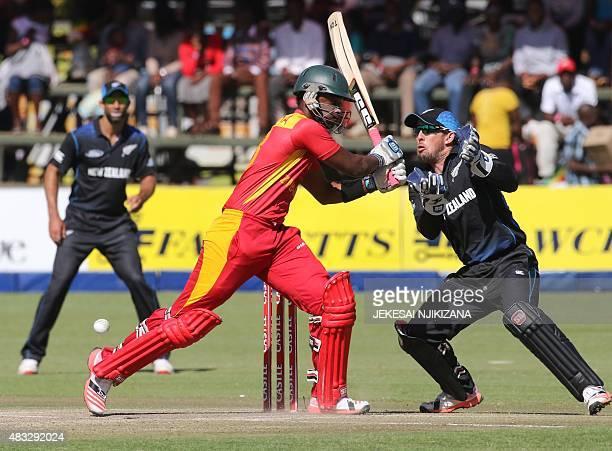 Zimbabwe's batsman Chamunorwa Chibhabha bats next to New Zealand's wicket keeper Luke Ronchi during the third and final game in a series of three...