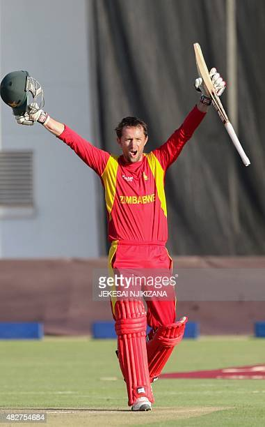 Zimbabwe's batsman Craig Ervine celebrates his century during the first game in a series of three One Day International cricket matches between...