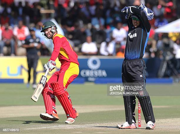Zimbabwe's batsman Craig Ervine runs between wickets as New Zealand's wicketkeeper Luke Ronchi looks on during the first game in a series of three...