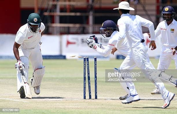 Zimbabwe's batsman Hamilton Masakadza survives a run out attempt by wicket keeper Kusal Janith Perera during the fifth day of the test cricket match...